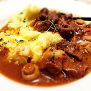 Beef Bourguignon served with rustic mash
